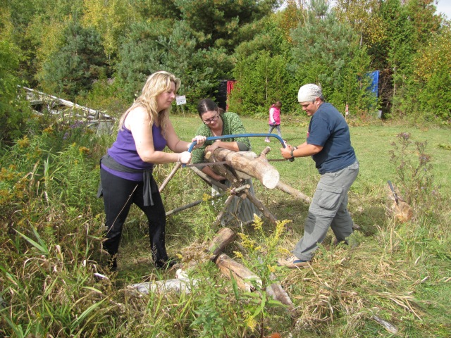 Able bodied participants help out with the community chores, such as procuring firewood.